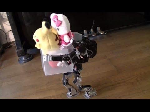 重い荷物を運ぶヒューマノイドロボット(The Humanoid robot which carries a heavy load.)