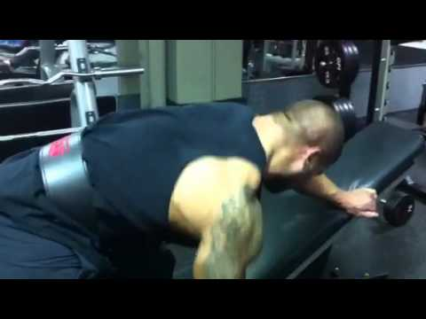 TRAINING: IFBB Pro Santana Anderson doing Dumbbell Rows.