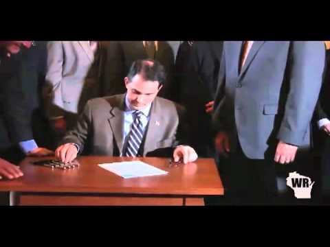 Walker signs bill to lower auto insurance rates into law.mov