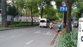 Xe ôm Grab Bike vừa nghe còi hụ liền nhường đường đoàn xe có CSGT mở đường