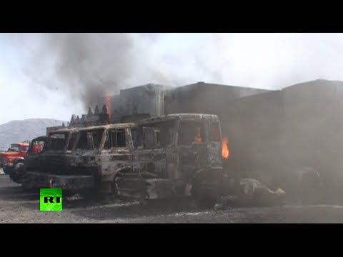 RAW: Triple Taliban suicide attack aftermath - 37 NATO fuel trucks burn