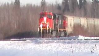 CN 2342 ES44DC and CN 5641 SD75I with Covered Hoppers