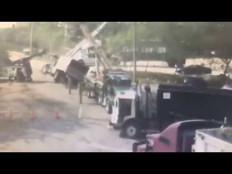 Boom Truck Hooks a Power line and Flips over