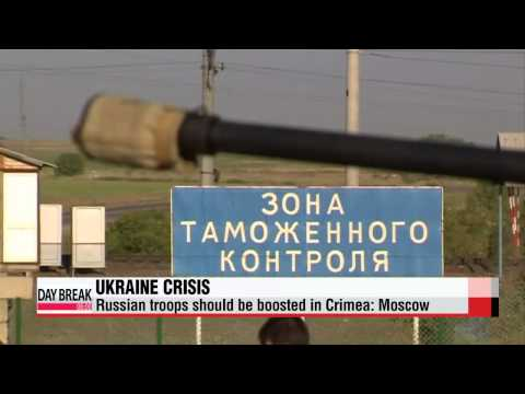 Russia's defense minister indicates need for more troops in Crimea