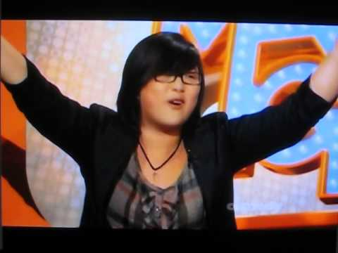 Woman sings anime theme song on a game show