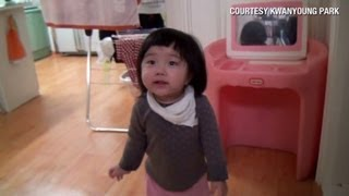 Distraction: Baby girl turns tables on dad