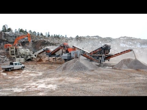 Hitachi Zaxis 670 LCH - Komatsu WA500-6 - Nordberg & Sandvik Crushers @ work in a quarry