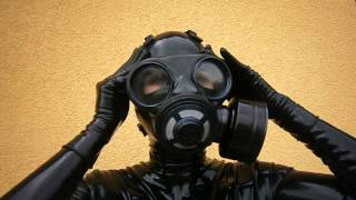 Latex catsuit and British gas mask