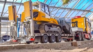 RC Heavy Transport of a Liebherr crawler loader to the construction site!
