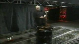 WWF RAW - Dustin Rhodes burns his Goldust ring attire .