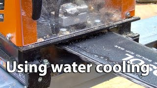 Water cooling on portable chainsaw mill.