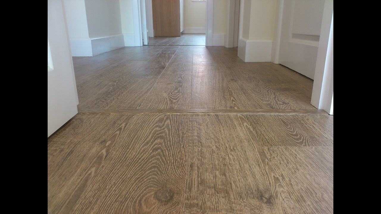 Quick step rustic oak natural planks laminate vogue for Quick step flooring ireland