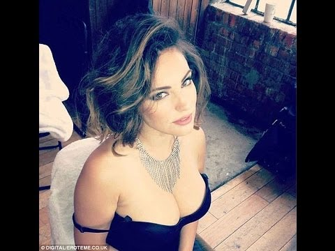 Kelly Brook shows off her ample cleavage in ANOTHER series of busty selfies