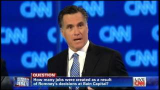 Romney defends Bain, \