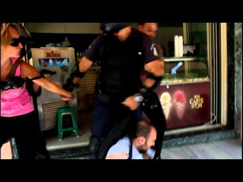 Police attacks peaceful solidarity demo to Kostas Sakkas underneath the Acropolis