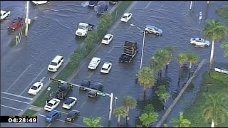 Officers block some flooded roads in Doral area