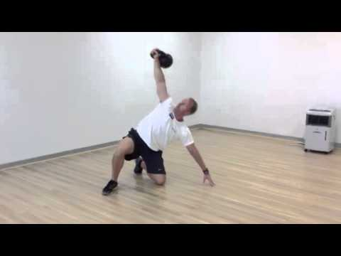Kettlebell Getups at Nexus Fitness Image 1