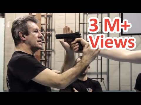 KRAV MAGA TRAINING • the fastest gun disarm Image 1