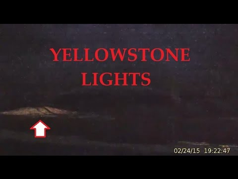 2/26/2015 -- ANOTHER Strange Light at Yellowstone -- Lights up distant geyser mound