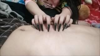 Leng long nails measure black polish apple skin brinjal scratch back arm