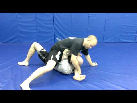 Spinning Knee on Belly to Triangle / Armbar / Americana Submissions Image 1