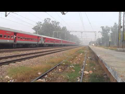 CNB WAP-4 hauling LHB Sampoorna Kranti Express giving way to...