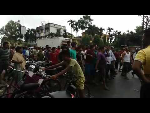 People protesting at Champasari as rain water enters into their homes