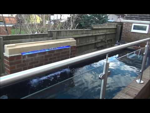 Large koi pond with viewing window pondguru how to for Koi pond window