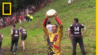 Watch a Downhill Cheese-Chasing Competition in Britain | National Geographic
