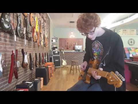 Hunter Playing a Tune in an Akron OH Guitar Shop