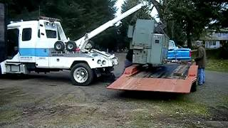 Machinery Moving with a Tow Truck