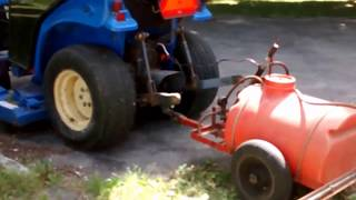 Spraying the Weed Killer on the Gravel Driveway