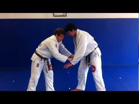 AJ Agazarm shows a Jiu Jitsu Single Leg Image 1