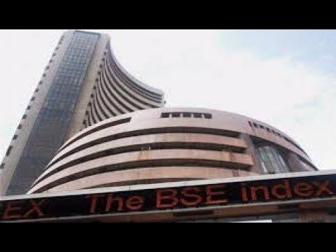 Sensex, Nifty slumps; Rupee down 8 paise