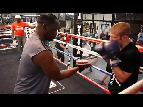TJ Dillashaw padwork with Jeff Mayweather
