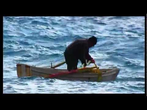 Ikaria fisherman's GREAT balance in a small Boat