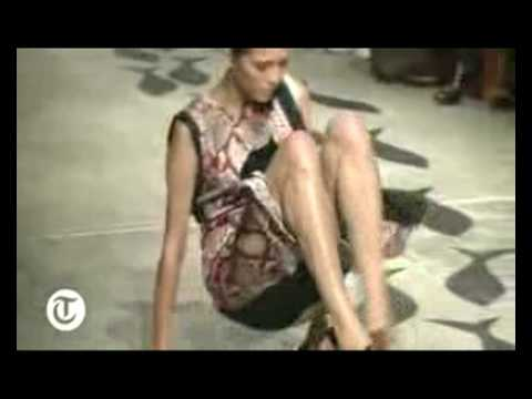 Models trips on prada catwalk