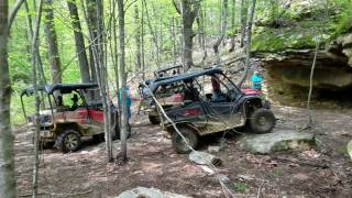 HONDA PIONEERS CRAWL OVER ROCKS GOING TO A CAVE