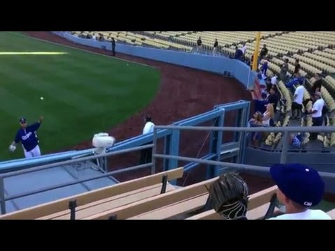 Ryu has a pregame toss with a fan in the bleachers