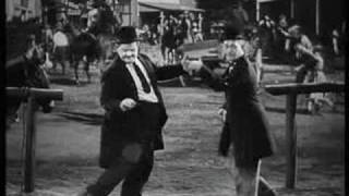 laurel and hardy dancing to torn on the platform