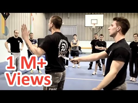 KRAV MAGA TRAINING • How to disarm a knife in your back Image 1
