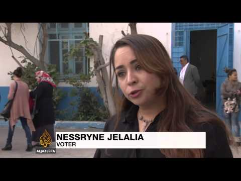 Tunisians vote in landmark presidential poll