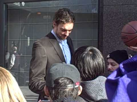 Pau Gasol of The Los Angeles Lakers signing autographs