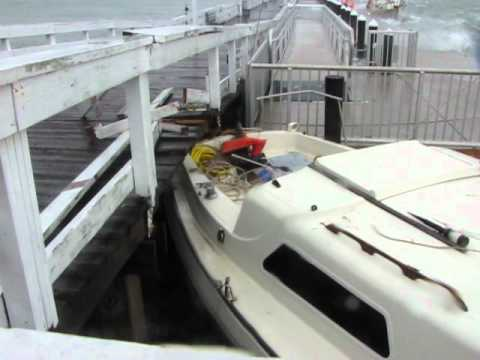Tropical Storm Debby - Man fights to save his sailboat amidst surge