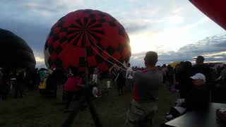 Ricardo and I with Paul, Standing the 66 balloon
