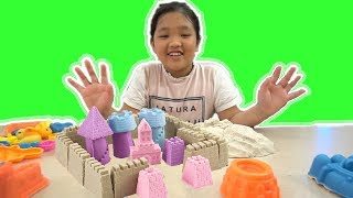 Play with big sand molds and toy shovels on outdoor playground / Surprise toys