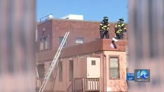 Firefighter falls through roof during working fire