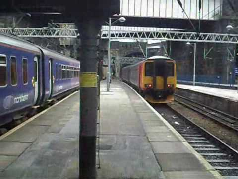 Two Class 156's at Liverpool Lime Street in differnet liveries East Midland Trains 156405 is departing with the 1252 To Norwich Northern Rail 156497 arriving...
