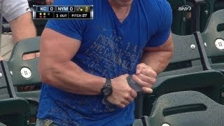 Muscular fan struggles with water bottle