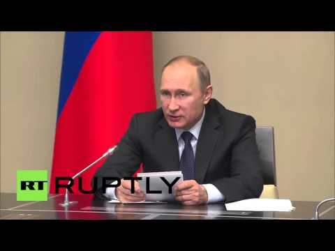 Russia: Putin praises Russian troop's 'professional manner' after Crimea drills